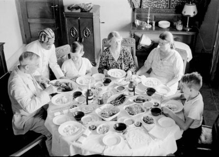 Dutch family eating rijsttaffel
